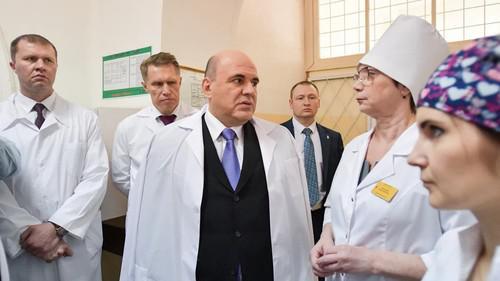 Слева направо: Евгений Нечаев, Михаил Мурашко, Михаил Мишустин